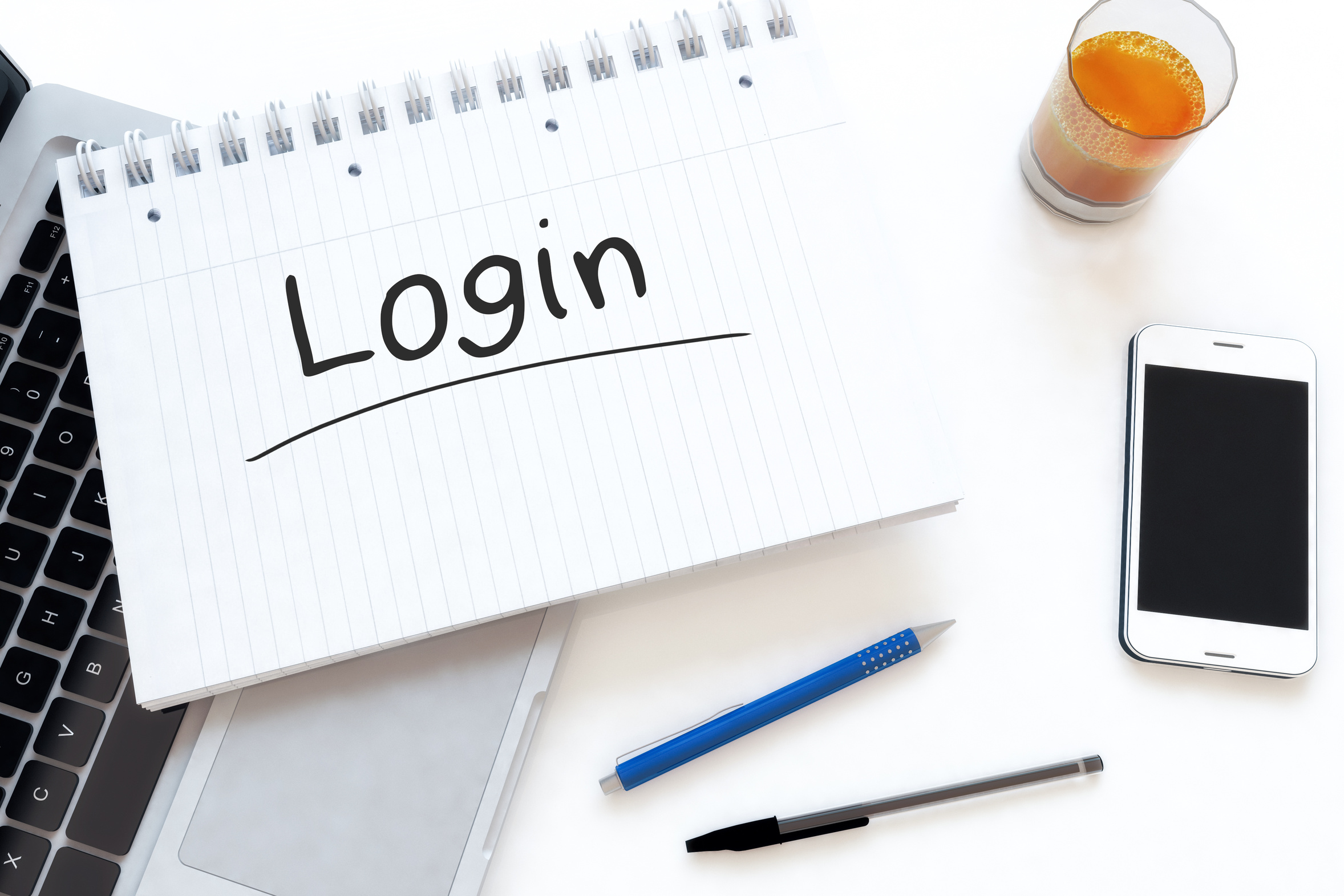 Image of a notepad with the text Login written on it